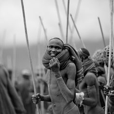 Surma warrior going to the Donga stick fighting - Ethiopia by Eric Lafforgue