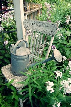 chippy white chair...old metal watering can....love...**