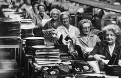 Workers at The Old Vinyl Factory in Hayes, West London stuffing The Beatles Rubber Soul into their covers.