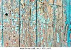 Peeling paint on weathered wood as a detailed background image - stock photo