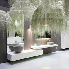 This is an amazing idea by French designer Patrick Nadeau. Manufactured by Italian Bathroom and kitchen designer, Boffi - the hanging moss or 'air plant' Tillandsias Usneoides, is draped over the lighting fixtures