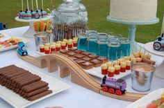 Thomas the tank engine dessert table. Blue Jelly cups. Train track