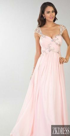 Pastel pink prom dress with diamanté detail on top half as well as on the shoulder straps.