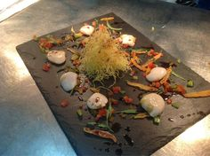 Sailor Jerry Ceviche Scallops, Peach, Tarragon, Heritage Tomatoes and Angel Hair Crisps finished with Pumpkin Oil served at Noble House in Hove