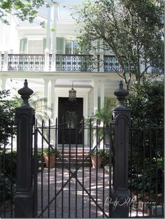New Orleans Garden District. Love the color, love the iron railings, gate, shutters old lantern