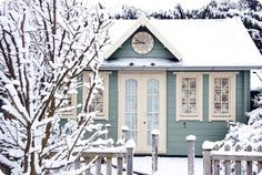 a lovely blue & white tiny cottage
