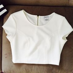 Woman Spring/Summer cropped top Perfect white waffle woven crop top.  Edgy zipper in the back.  It's been wore once, perfect nearly new.  Stylish and ready . Tops Crop Tops