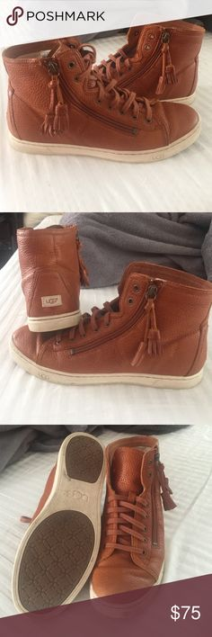 UGG Sneakers High Top brown leather UGG sneakers. Fun tassel. True to size Woman's 9. Worn but in Great shape. UGG Shoes Sneakers