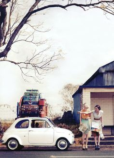 -like the concept of the suitcase on the car, and the people standing next to it