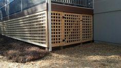 Custom lattice with door under a deck