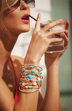 I love the whole Ippolita line, but it is SO expensive! She's wearing $5,000 in bracelets.