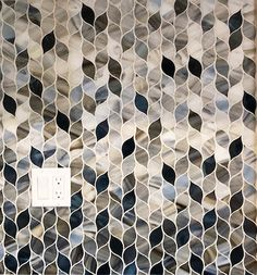 The Laurel tile is one of our most popular and versatile patterns. Glass Tile Backsplash, Touch Of Gray, Glass Installation, Warm Grey, Florida Home, Beautiful Kitchens, Kitchen Inspiration, Colored Glass, Light In The Dark