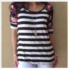 Chic striped floral detail top Striped chic floral detail top PLEASE Use the Poshmark new option you can purchase and it will give you the option to pick the size you want ( all sizes are available) BUNDLE and save 10% ( no trades price is firm unless bundled) NO OFFERS THIS IS MY LOWEST PRICE Tops