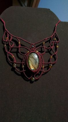Necklace made using the art of macrame, with natural semiprecious stone and waxed thread of high quality ( Linhasita ) in this case whit a beauty and unique labradorite stone and labradorite beads. The waxed threads are very strong, waterproof and it does not create any type of