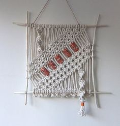 """Hand made macramé wall hanging. Made from cotton rope (3/16""""). Choose your beads! Choose from a verity of 2"""" colored fabric beads (5). If you don't"""