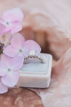 Diamond engagement ring and pink flowers make the ultimate romantic photo. Halo Engagement Rings, Engagement Session, Biltmore Estate, Vintage Style Rings, Halo Setting, Romantic Photos, Types Of Rings, Unique Rings, Wedding Bands