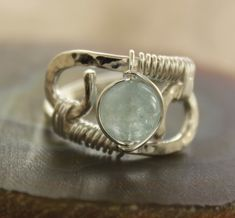 Sterling silver ring with round pale blue aquamarine stone