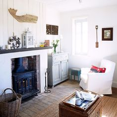 Living room fireplace | Take a tour around this stunning coastal home | housetohome.co.uk | Mobile