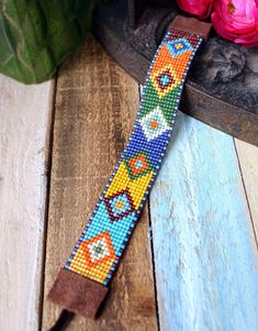 Embroidery Bracelets Ideas - Cool hand loomed bracelet, patterned after Aztec / Native American Peyote patterns. Handmade with hundreds of tiny glass beads. Wearable art by Ever Designs Jewelry. Beaded Bracelets Tutorial, Bead Loom Bracelets, Beaded Bracelet Patterns, Bead Loom Patterns, Peyote Patterns, Jewelry Patterns, Handmade Bracelets, Beading Patterns, Beaded Jewelry