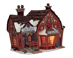 Lemax Ye Olde Silversmith. SKU# 15547. Introduced in 2001 and retired in 2006, this porcelain Lighted building was made for the Caddington Village Collection.