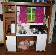 repurpose an entertainment center into kids play kitchen