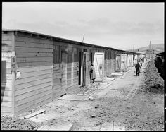 June 16, 1942 —San Bruno, California. This scene shows one type of barracks for family use. These were formerly the stalls for race horses. Each family is assigned to two small rooms, the inner one, of which, has no outside door nor window. The center has been in operation about six weeks and 8,000 persons of Japanese ancestry are now assembled here.