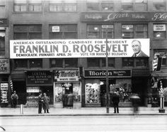 Shops in Worcester, Massachusetts with a banner across the second floor windows urging people to vote for FDR in the upcoming primary on April 26. April 1932.