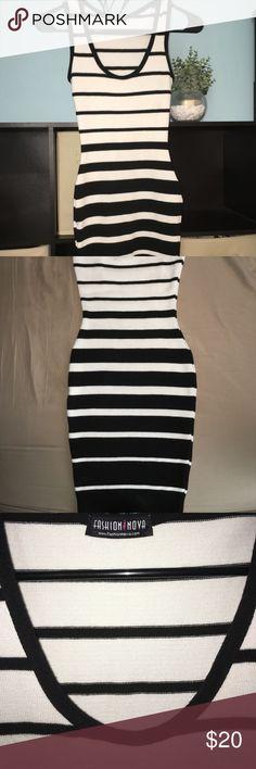 Tight striped dress Black and white striped tight body con dress, wore once Fashion Nova Dresses Mini