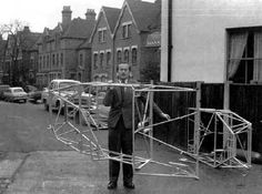 AZHAR Architecture  AUTOMOTIVE CARS  Lotus Cars  Colin Chapman  Historic  Holding Chasis over his head outside home in North London (possibly his Fathers Pub in Hornsey?)