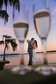 We love this creative way to include one of your wedding keepsakes, like your toasting flutes, in your wedding photos!