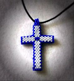 This cross pendant is perfect for a man or a woman, and makes a lovely gift. It is considered '3D', as the cross is tubular, rather than flat.  The pendant measures approximately 2 inches from top bead to bottom bead, in length.  *Pendant ONLY