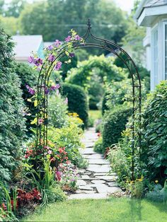 Beautiful idea for a trellis entrance between a front and side yard (or, in my case, between the side and back yards