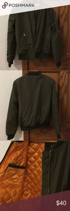NWOT Olive Bomber Jacket Brand new, never worn. Olive green, orange lining. Has a pocket on the inside & a zippered pocket on the sleeve. It's a medium, but it seems like a small. I purchased it from a boutique on here and it does not fit me how I'd like it to. I can't return it, so just trying to make my money back. Jackets & Coats Utility Jackets