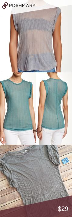 FREE PEOPLE Sheer Muscle Tee Large NWT FREE PEOPLE Sheer Muscle Tee Large NWT. Color is grey! Wear it with a bralette or a cami for a sexy and comfy style! Retails at $38 Free People Tops Muscle Tees