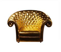 4003 GOLD CHAIR ECO LEATHER TUFTED WITH ROLLED ARM AND BACK This tufted chair combines exquisite, rolling contours with a gorgeous color. Upholstered in a beautiful gold leather, this chair brightens up any room. Not only is it extremely comfortable to relax in after a long day, it looks magnificently glam in any room. This gold leather is in high demand by celebrities at the moment.