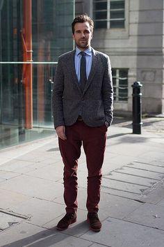 Shop this look on Lookastic:  http://lookastic.com/men/looks/desert-boots-chinos-belt-blazer-tie-longsleeve-shirt/5087  — Burgundy Suede Desert Boots  — Burgundy Chinos  — Dark Brown Leather Belt  — Charcoal Wool Blazer  — Charcoal Wool Tie  — Blue Long Sleeve Shirt