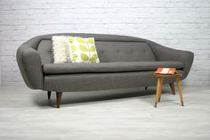 A 1950s/60s reupholstered Greaves & Thomas sofa.  cgi.ebay.co.uk/... www.facebook.com/...