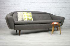 A 1950s/60s reupholstered Greaves & Thomas sofa