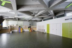 Kindergarten Lotte. Play space includes cupboards, laddersm slides and platforms for different types of play.