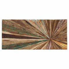 """Featuring a radiating burst motif, this planked wood wall decor brings an eye-catching touch of texture to any space.  Product: Wall decor Construction Material: WoodFeatures:  Radiating burst motifPlanked wood designDimensions: 14"""" H x 20"""" W x 1"""" D"""