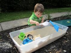 Small DIY sand box out of plastic storage bin. No worries about cats using it as a litter pan.