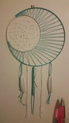 My giant crescent moon shape dream catcher i made with natural feathers and turquoise