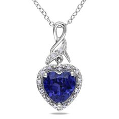 This pretty birthstone necklace from the Miadora Collection features a heart-cut created blue sapphire and round white diamonds set in sterling silver. This heart pendant is hung on a cable chain and is secured with a spring ring clasp.
