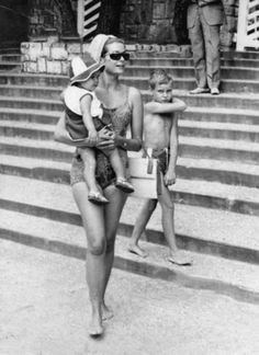 Princess Grace at the Monte-Carlo Beach Club with her children Stephanie (1 year old) and Albert (8 years old), 1966.
