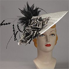 • Fascinator  • Design by Louise Green   • Fabric: Buntel, Flowers, Feathers   • Colors: Silver w/ Black