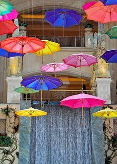 Umbrellas as ceiling decor #colorfulweddings #brightweddingcolors