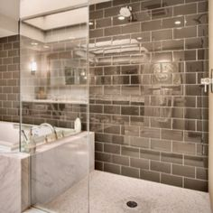 Silver master shower bath subway tiles are amazing! Looks fantastic with white marble tub surround. <3