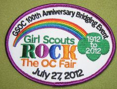 Girl Scouts Orange County 100th anniversary patch. Girl Scouts ROCK The OC Fair Bridging Event, July 27, 2012. An ebay score.