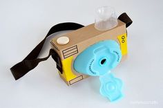 An empty tissue box becomes the main part of this toy camera, and a plastic lid from a cleaning bottle or shampoo container becomes the camera lens. perfect for backyard exploring!