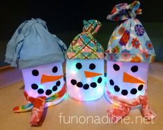 Snowman lanterns made from plastic containers (milk jug and vinegar bottles). Perfect recycle project!